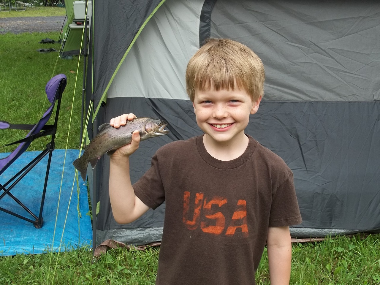 Little boy holding a fish